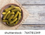 pickles . marinated cucumber in ... | Shutterstock . vector #764781349