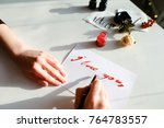 female master of calligraphy... | Shutterstock . vector #764783557