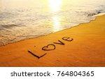 love heart text written in sand ... | Shutterstock . vector #764804365