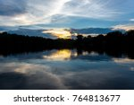 sunset along the banks of the... | Shutterstock . vector #764813677