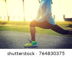 young fitness woman stretching... | Shutterstock . vector #764830375