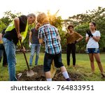 group of people plant a tree... | Shutterstock . vector #764833951