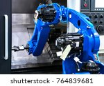 close up robot hands in milling ... | Shutterstock . vector #764839681