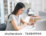 asian woman writing in the... | Shutterstock . vector #764849944
