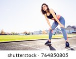 young sporty woman taking... | Shutterstock . vector #764850805