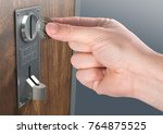 a male hand ready to insert a... | Shutterstock . vector #764875525