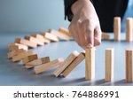 businessman hand stop dominoes... | Shutterstock . vector #764886991