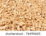 Background of roasted peanuts with shallow depth of field. - stock photo