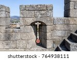Small photo of Arrow slit, crosslet loop or an arbalestina, in a merlon on top of the donjon, also called the keep, of the castle in Braganca, Portugal