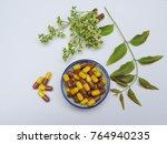 alternative medicine tablets... | Shutterstock . vector #764940235