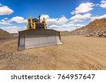 Excavator On A Road...