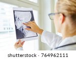 doctor analyzing x ray image... | Shutterstock . vector #764962111