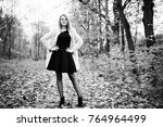 young blonde girl at pink coat...   Shutterstock . vector #764964499