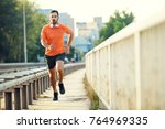 young athlete man is exercising ... | Shutterstock . vector #764969335