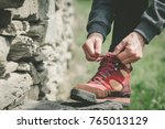 hands of woman lacing her shoes ... | Shutterstock . vector #765013129