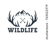 """Hand drawn inspirational label with mountains and antlers textured vector illustrations and """"Wildlife"""" lettering. 