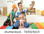 young mother with cute kids... | Shutterstock . vector #765025615