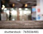 empty dark wooden table in... | Shutterstock . vector #765036481