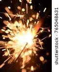 sparkler burning on the black... | Shutterstock . vector #765048631