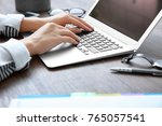 woman using laptop on wooden... | Shutterstock . vector #765057541