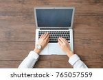 woman using laptop on wooden... | Shutterstock . vector #765057559
