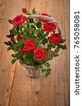 red roses in basket  on wooden...   Shutterstock . vector #765058081