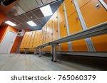 locker room with rows of orange ... | Shutterstock . vector #765060379