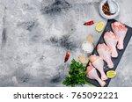 raw chicken legs on a black... | Shutterstock . vector #765092221