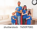 a young family in red and blue... | Shutterstock . vector #765097081