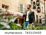 young tourist male walking with ... | Shutterstock . vector #765115435