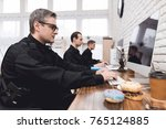 police officers work at a... | Shutterstock . vector #765124885