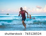 triathletes running out of the... | Shutterstock . vector #765128524