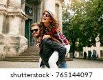tourist couple. beautiful woman ... | Shutterstock . vector #765144097