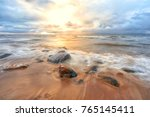 autumn sunset in the baltic sea | Shutterstock . vector #765145411
