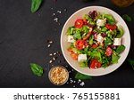 dietary salad with tomatoes ... | Shutterstock . vector #765155881