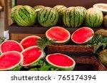 ripe juicy watermelons on a... | Shutterstock . vector #765174394