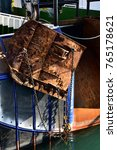 Small photo of Closeup of rusty trawl door on the stern of a Trawler fishing boat. Vertical view.