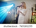 beautiful blonde vocal singer... | Shutterstock . vector #765181255