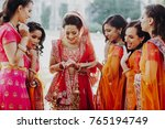 pretty hindu bridesmaids... | Shutterstock . vector #765194749