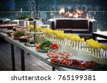 buffet served table with snacks ... | Shutterstock . vector #765199381
