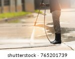worker cleaning driveway with... | Shutterstock . vector #765201739
