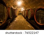 Wine Barrels And Bottles In A...