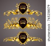 set of golden royal shields... | Shutterstock .eps vector #765258079