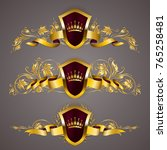 set of golden royal shields... | Shutterstock .eps vector #765258481