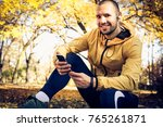 take a break from exercise.... | Shutterstock . vector #765261871