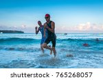 triathletes running out of the... | Shutterstock . vector #765268057