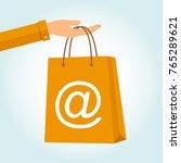 hand holding a bag shopping... | Shutterstock .eps vector #765289621