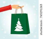 hand holding a bag shopping for ...   Shutterstock .eps vector #765291265