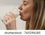 woman drinking milk. weight... | Shutterstock . vector #765296185