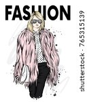 beautiful stylish girl in a fur ... | Shutterstock .eps vector #765315139